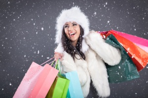 sexy girl wearing santa claus clothes with color bag